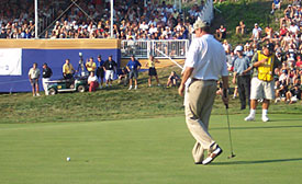 Neil Lancaster walking up to his disappointing attempt at a bogey putt.